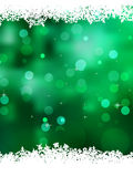 Green background with snowflakes. EPS 8 Stock Image