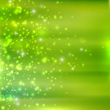 Green background with sparkles Royalty Free Stock Photo