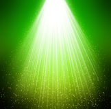 Green background stars and rays Stock Image