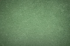 Green background texture of rough asphalt, top view Stock Images