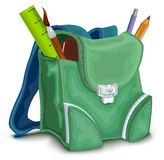 Green backpack with school supplies Stock Images