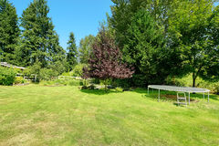 Green backyard with trampoline Royalty Free Stock Photos
