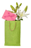 Green bag with a box and flowers Royalty Free Stock Photography
