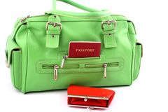 Green bag and red wallet Stock Image