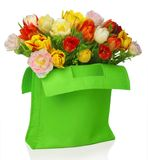 Green bag with tulips Royalty Free Stock Photos