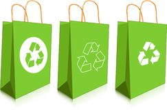 Green bags. Empty paper shopping bags with ecology symbols Royalty Free Stock Photos