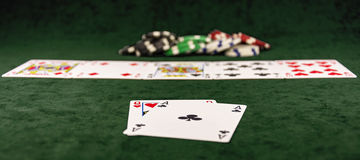 On the green baize poker is the distribution of cards Royalty Free Stock Photography