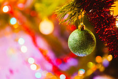 Green ball on a background of green Christmas tree branches Stock Photography