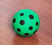 Green ball with black spots Royalty Free Stock Photography