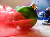 Green ball on Christmas tree. Beautiful festive greeting card with colorful balloons and décor Royalty Free Stock Images