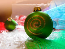 Green ball on Christmas tree. Beautiful festive greeting card with colorful balloons and décor Stock Photography