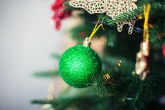 Green ball on the Christmas tree. The concept of Christmas and N Stock Images