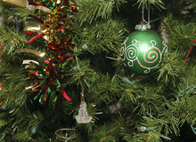 Green Ball and Glass Ornament on Christmas Tree Royalty Free Stock Image