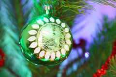 Green ball hanging on pine branches Royalty Free Stock Photos