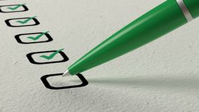 Green ball pen crossing off items from a checklist Stock Image