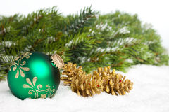 Green ball with pinecone Stock Photo