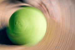 Green ball radial blur Royalty Free Stock Photo