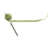 A green ball of yarn with a crochet Stock Photo