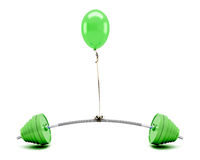 Green balloon lifting a barbell Royalty Free Stock Images