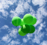 Green balloons fly away in the sky Royalty Free Stock Photography