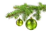 Green balls on christmas tree branch. Green balls hanging on a christmas tree branch, isolated royalty free stock photography