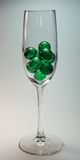 Green Balls in Glass. Green bath beads in clear wine glass Royalty Free Stock Photos