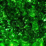 Green balls hydrogel in a glass. Royalty Free Stock Photo