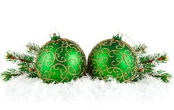 Green balls on snow with branch firtree Royalty Free Stock Photography