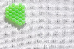 Green balls on white linen Stock Photos