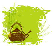 Green bamboo branch and teapot Royalty Free Stock Photography