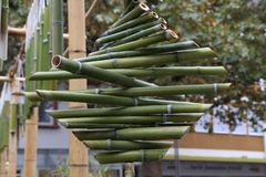 Green bamboo sticks. Green Bamboo tubes hang around the house. Green Bamboo tubes hang around the house stock image