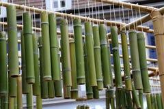 Green bamboo sticks. Green Bamboo tubes hang around the house. Green Bamboo tubes hang around the house royalty free stock photo