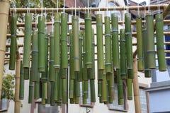 Green bamboo sticks. Green Bamboo tubes hang around the house. Green Bamboo tubes hang around the house stock photo