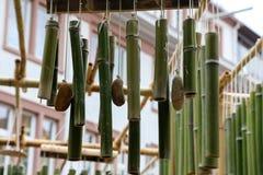 Green bamboo sticks. Green Bamboo tubes hang around the house. Green Bamboo tubes hang around the house royalty free stock image