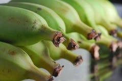 Green Banana. Closeup with reflection Royalty Free Stock Photos
