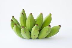 Green banana. Green fresh banana on the white pattern Royalty Free Stock Photography