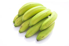 Green bananas. On a pure white background Royalty Free Stock Images