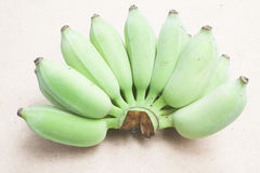 Green bananas on wood background Stock Images