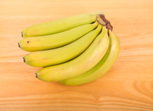 Green Bananas on Wood Table Stock Photos