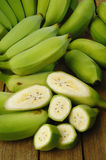 Green bananas. On wooden background Stock Image