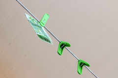 Green banknote 100 euro in a green clothes peg. Green banknote 100 euro in green clothes peg Stock Photos