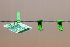Green banknote 100 euro in green clothes peg. Green banknote 100 euro in a green clothes peg Royalty Free Stock Photo