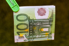 Green banknote 100 euro in green clothes peg. Green banknote 100 euro in a green clothes peg Stock Photo