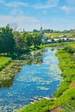 Relax on Kamenka river bank in Suzdal. The green banks of Kamenka river are the best places to relax, have some picnic or enjoy the views, Suzdal, Russia Stock Photography