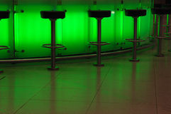 Green bar. Bar stools in green light stock photo