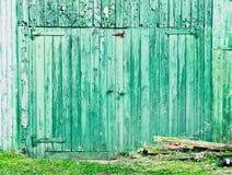 Green barn door. A green wooden barn wall and door in England Stock Photo