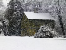 Green barn in a snow storm Royalty Free Stock Photography