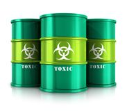 Green barrels with toxic substances. Creative abstract poisonous and dangerous materials disposal and utilization industry concept: group of green metal barrels Royalty Free Stock Photo