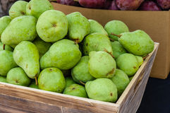 Green bartlett pears for sale at market Royalty Free Stock Images