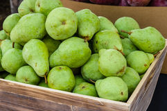 Green bartlett pears for sale at market Stock Images